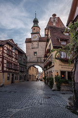 Old road (gusmartinie) Tags: ancient holidays rothenburg building historic arch old landmark germany city romantischestrase sky destination town road village romantic route urban scenery medieval travel tower franconia tourism bavaria gate rothenburgobdertauber europe heritage architecture