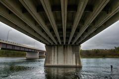 Overpowering (Spence D) Tags: bridge river stoneytrail calgary alberta fisherman water