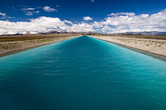 The blue canal (paolo_barbarini) Tags: channel river newzealand landscape nature water blue clouds travel canal pukaki