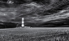 The tower in the dark (David Feuerhelm) Tags: landscape blackandwhite bw monochrome noiretblanc schwarzundweiss blancoynegro contrast sky clouds stubble field lighthouse building tower wideangle infrared ir countryside coast norfolk happisburgh uk england nikon d90 sigma1020mmf456 atmospheric