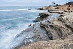 La Jolla Beach Scene (Photos By Clark) Tags: california lajolla cities subjects beachshots location canon2470 unitedstates northamerica sandiego canon5div locale places where us rocks waves pacific longexposure 10seconds blue green lifeguard thesandiegoist