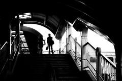 Setting sun (明遊快) Tags: couple stairs japanese people bw sunlight monochrome city step bridge station dusk evening silhouette street lines