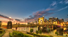 Surnise over the Allegheny River (tquist24) Tags: hdr nikon nikond5300 pennsylvania pittsburgh robertoclementebridge architecture bridge city cityscape clouds downtown geotagged lights longexposure morning reflection reflections river sky skyscraper skyscrapers sunrise water unitedstates