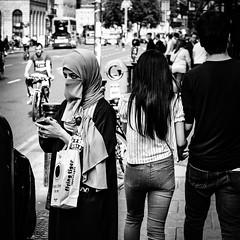 Tiger eyes (Kieron Ellis) Tags: man woman pavement road cyclist bike traffic croud walking standing candid street blackandwhite blackwhite monochrome