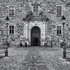 The castle entrance (Tim Ravenscroft) Tags: castle orebro entance architecture sweden doorway hasselblad hasselbladx1d monochrome blackandwhite blackwhite