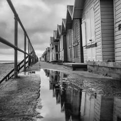 Cromer Beach Huts on film (StuMcP) Tags: cromer beachhuts seaside wet summer reflections yashicamat124g ilford400 moody stuartmcpherson beach norfolkcoast norfolk