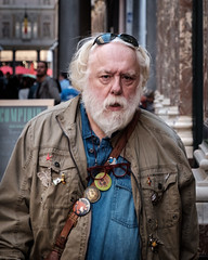 Street Character Brussels. (James- Burke) Tags: man candid belgium brussels streetphotography badges candidportrait portrait character street