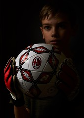 The dream ball. (GlebLv) Tags: sony sel50f18 a6000 portrait portraiture lowkey boy ball acmilan acm
