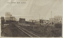 c. 1910 Real Photo Postcard - Town View showing Grain Elevators and the CPR Train Station at High River, Alberta, Canada (Treasures from the Past) Tags: postcard highriver alberta grainelevator trainstation cpr canadianpacificrailway townview canada