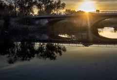 Bridge in a sunset (Sandronn) Tags: bridge river sunset sun water