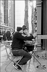 'Hi There' - Bryant Park, NYC (TravelsWithDan) Tags: couple outdoors winter city urban seated tableandchairs nyc bw newyorkcity bryantpark blackandwhite candid streetphotography pigeon sunshine canong3