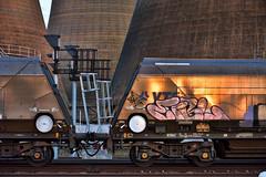 Sunset Industry (whosoever2) Tags: uk united kingdom gb great britain england nikon d7100 train railway railroad october 2018 drax power station hoa coal hopper bogie cooling tower sunset reflection graffiti signal