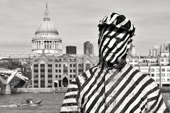 Leading Lines in London.... (markwilkins64) Tags: bridge portraiture portrait london southbank uk streetphotography street candid blackandwhite mono monochrome bw lines stripes fancydress sculpture humansculpture humanart mark markwilkins riverthames thames thethames stpaulscathedral millenniumbridge boat thecity urban streetartist man