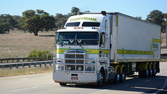 Passing Bowning (3/6) (Jungle Jack Movements (ferroequinologist)) Tags: rowans griffith kenworth k200 sticky fingers fruithaul caboolture qld nsw maddens harden tumut haulage truck art iveco scania qube logistics bowning hume highway new south wales hp horsepower big rig haul freight cabover trucker drive transport carry delivery bulk lorry hgv wagon road nose semi trailer deliver cargo articulated vehicle load freighter ship move motor engine power teamster tractor prime mover diesel driver cab cabin loud beast wheel exhaust double b grunt