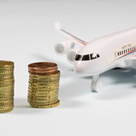 Coin stacks in front of airplane thumbnail
