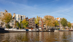 Canals of Amsterdam VII (Jack Landau) Tags: amsterdam city urban architecture road street buildings netherlands canon 5d jack landau boat water sky building tree river skyscraper waterfront