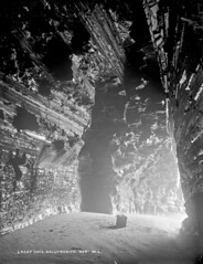 Lead kindly light... (National Library of Ireland on The Commons) Tags: robertfrench williamlawrence lawrencecollection lawrencephotographicstudio thelawrencephotographcollection glassnegative nationallibraryofireland greatcave ballybunion countykerry kerry beach cave longexposure tide layers sediment rocks rock geology caveview cameraequipment box lowtide sand y