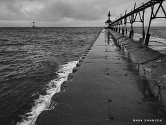 Slippery Pier (mswan777) Tags: mobile iphone iphoneography apple white black monochrome ansel seascape coast lighthouse horizon sky cloud weather wind wet nature outdoor wave water splash pier