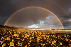 Lucky in light at Llanddulas (Pete Rowbottom, Wigan, UK) Tags: wales northwales dawn rain rainbow light shadows sea coast beach rocks sky outdoor clouds landscape seascape orange red yellow uk wideangle storm weather peterowbottom nikond810 waves nature abergele colwynbay wetweather sunrise earlymorning ukcoast rock bay autumn cymru goldenlight goldenhour beauty dramatic geotagged lucky llanddulas doublerainbow