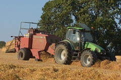 Deutz Fahr Agrotron 135 Mk3 Tractor with a Massey Ferguson 185 Series 2 Cut Chamber Baler (Shane Casey CK25) Tags: deutz fahr agrotron 135 mk3 tractor massey ferguson 185 series 2 cut chamber baler deutzfahr sdf df grain harvest grain2018 grain18 harvest2018 harvest18 corn2018 corn crop tillage crops cereal cereals golden straw dust chaff county cork ireland irish farm farmer farming agri agriculture contractor field ground soil earth work working horse power horsepower hp pull pulling cutting knife blade blades machine machinery collect collecting nikon d7200 traktor traktori tracteur trekker trator ciągnik castlelyons