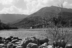River (sam.naylor) Tags: italy europe travel medium format film fuji nature mountain mountains hills countryside medieval history stone bobbio town ancient street summer warm 35mm contax g1 rangefinder colour viaduct sky bridge black white monochrime grey ilford fp4
