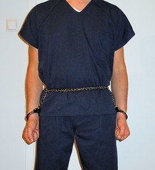 jail hopping: different facilities, different clothing, different restraints (rainerzufall1234) Tags: handcuffs handcuffed inmate uniform prisoner jail bellychain restraint