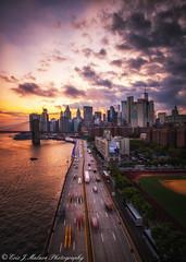 Downtown from Manhattan Bridge Sunset (ericjmalave) Tags: 1855 cityscape fujix fujixf1855 fujixt10 landmarks longexposure newyorkcity nightlights nyc samyang12mm twilight brooklynbridge manhattanbridge cartrail sunset