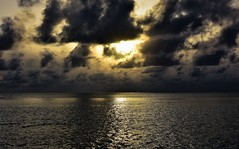 Sunset before the storm. (pstone646) Tags: indianocean sunset clouds water ocean reflections sky maldives moody sun ripples waves calm storm light horizon