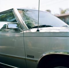 Redwood City (bior) Tags: hasselblad500cm carlzeiss portra160nc kodakportra expiredfilm mediumformat 120 6x6cm suburbs redwoodcity car classiccar auto turbo electronicfuelinjection