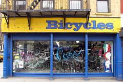 Gone But Not Forgotten (Eddie C3) Tags: manhattan newyorkcity hellskitchen metrobicycle streetscenes storefronts storewindows urbanscenery