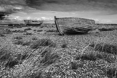 Things Left Behind (25) (Dungeness)-03281 (G.K.Jnr.) Tags: landscape seascape historic foliage vegetation boat transport deserted desolate discarded dilapidation water sea seaside coastline beach shingle outdoor sky scenic interest touristattraction monochrome bw blackandwhite blackwhitephotos rural dungeness romneymarsh kent unitedkingdom fujix apsc xh1 wood
