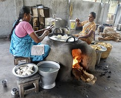 Women making snacks for sale, Chettinad (Yekkes) Tags: work cooking kitchen india asia tamilnadu chettinad fire stove oven food frying oil sari