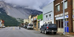 213th Street, Bellevue, Municipality of Crowsnest Pass, Alberta .. (edk7) Tags: nikond300 nikonnikkor18200mm13556gedifafsvrdx edk7 2008 canada alberta southernalberta rockymountains easternrockies municipalityofcrowsnestpass bellevue mainstreet 213thstreet architecture building oldstructure city cityscape urban rural pickup truck car vehicle mountain geology earth rock rockslide landslide cloud pavement vegetation scrub scree road tree sky