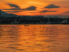 October Sunrise over Split (Ian M Bentley) Tags: split croatia dalmatiancoast adriatic adriaticsea calmsea sea calm harbour port morning morninglight sunrise orange yellow red olympus omd em1ii tamron14150mm lens megazoom wideangle reflections adriaticsunrise still waters outdoor sky clouds serene solice october 2018 autumn dawn landscape waterscape silhouette boat bay water ocean cloud mountains