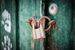 Closed tightly (iamunclefester) Tags: vacation holiday croatia krk otokkrk wood wooden door doorknob padlock lock key green lines hand print handprint hands texture figure rusty old decay paint painted varnish ring closed closeup close used shabby