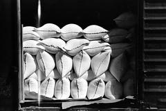 Freight car loaded with sacks of flour, Pillsbury mills, Minneapolis, Minnesota, September 1939. (polkbritton) Tags: 1930s johnvachon trains minnesotahistory fsaowi libraryofcongresscollections blackwhite