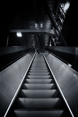 Urban Traveller (Ian Smith (Studio72)) Tags: rx100 sonyrx100 sony uk england london canarywharf heronquays dlr station escalator goingup upwards stairs urban city architecture modernlondon travelling travel bw bnw nb blackandwhite mono monochrome studio72