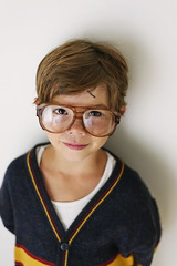 """He had to show me he REALLY is Harry Potter, complete with a sharpie """"scar"""" (Elizabeth Sallee Bauer) Tags: 6yearold boy child childhood glasses happy kid portrait smiling sweater"""