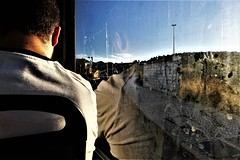 looking through the window (*F~) Tags: lisboa portugal bus movement motion light sunlight nature humans people urban city graffiti walls reflections sun lumière luz time thehours