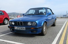 A Long Way from Home (occama) Tags: alongwayfromhome bmw 320i convertible 1980s 1990s blue jersey reg plate registration number old car cornwall uk german sea sun