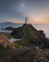 Twr Mawr lighthouse and the crescent Moon (willblakeymilner) Tags: nikon lighthouse moon beautiful nature seascape ocean rocks light sunset sunlight tamron twilight sky wales anglesey twr mawr