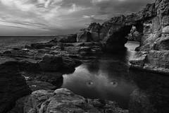 Osserva #2 (nicolamarongiu) Tags: biancoenero blackandwhite monocromo fantasy surrealism landscape paesaggio occhi mare acqua scogli arco arc sardegna sardinia ispraneddas sunset