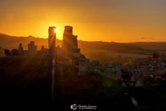 Corfe Castle Sunburst (Christian Lawrence Photography) Tags: sunrise sunburst dorset castle landscape glow golden corfecastle fuji