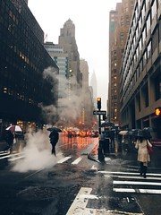 Rising From the Smoke (Airicsson) Tags: nyc newyork city urban manhattan street midtown umbrella rain storm chrysler building usa iphone