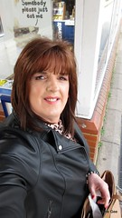 Selfie at Stevenage, I promise I did not see the sign behind me. (janegeetgirl2) Tags: transvestite crossdresser crossdressing tgirl tv ts heels nylons glamour ankle boots summer shirt dress jane gee outside promenade brighton leopard biker jacket black
