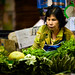 Woman selling cooking greens at Warorot Market in Chiang Mai, Thailand