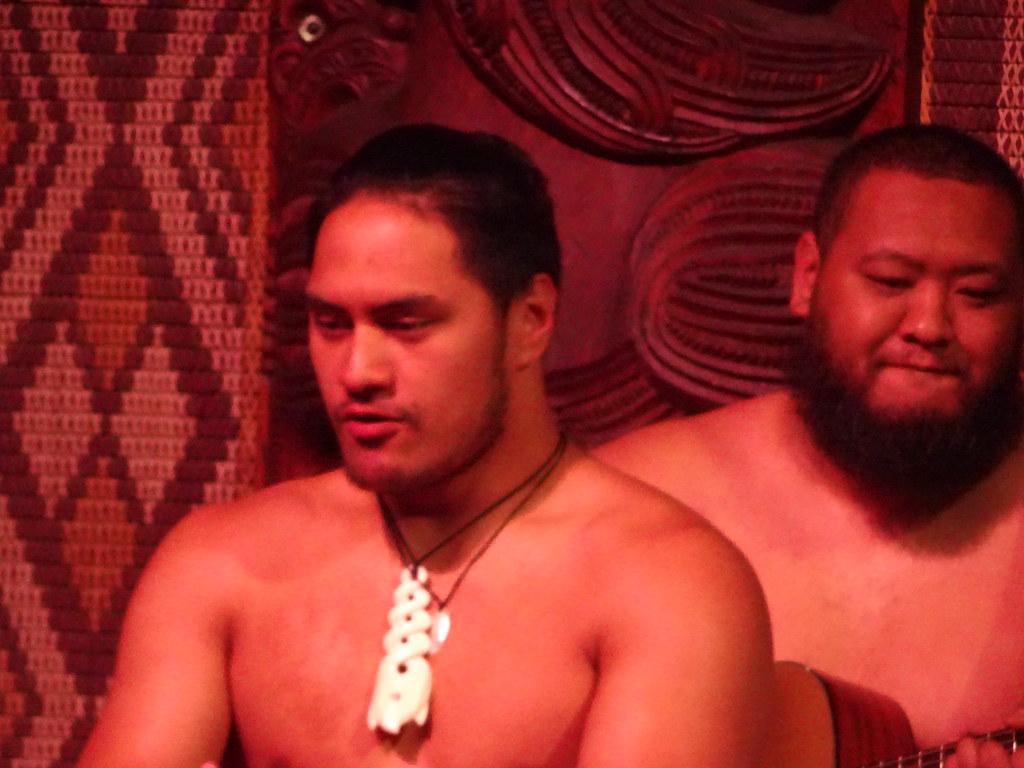 Waitangi. Young Maori men dancing at the Waitangi Treaty grounds.