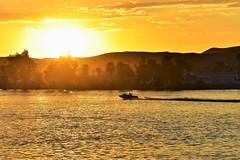 Big sunset (thomasgorman1) Tags: sunlight sundown river boat boating recreation shore desert nikon trees hills nature colorado az arizona sky clouds