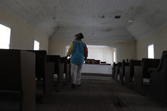 Hillman walks through the dilapidated, abandoned St. Paul's AME Church in Greensboro. St. Paul's used to be a common place for worship and gatherings in the African-American community in Greene County.