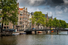 Amsterdam, Netherlands (rmk2112rmk) Tags: amsterdam netherlands holland city bridge canal river waterway architecture buildings cityscape streetview water reflection coffeeshop